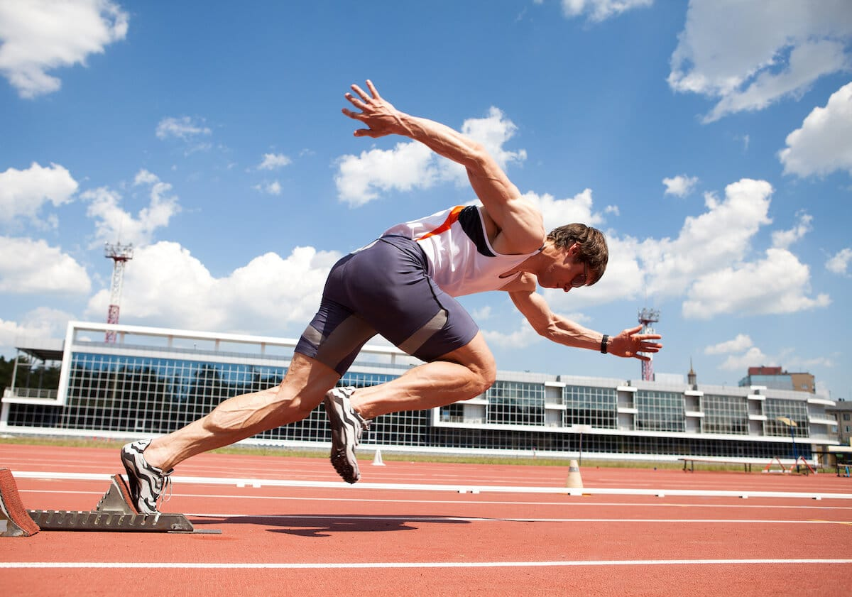 Supplements for athletes: athlete running on a track