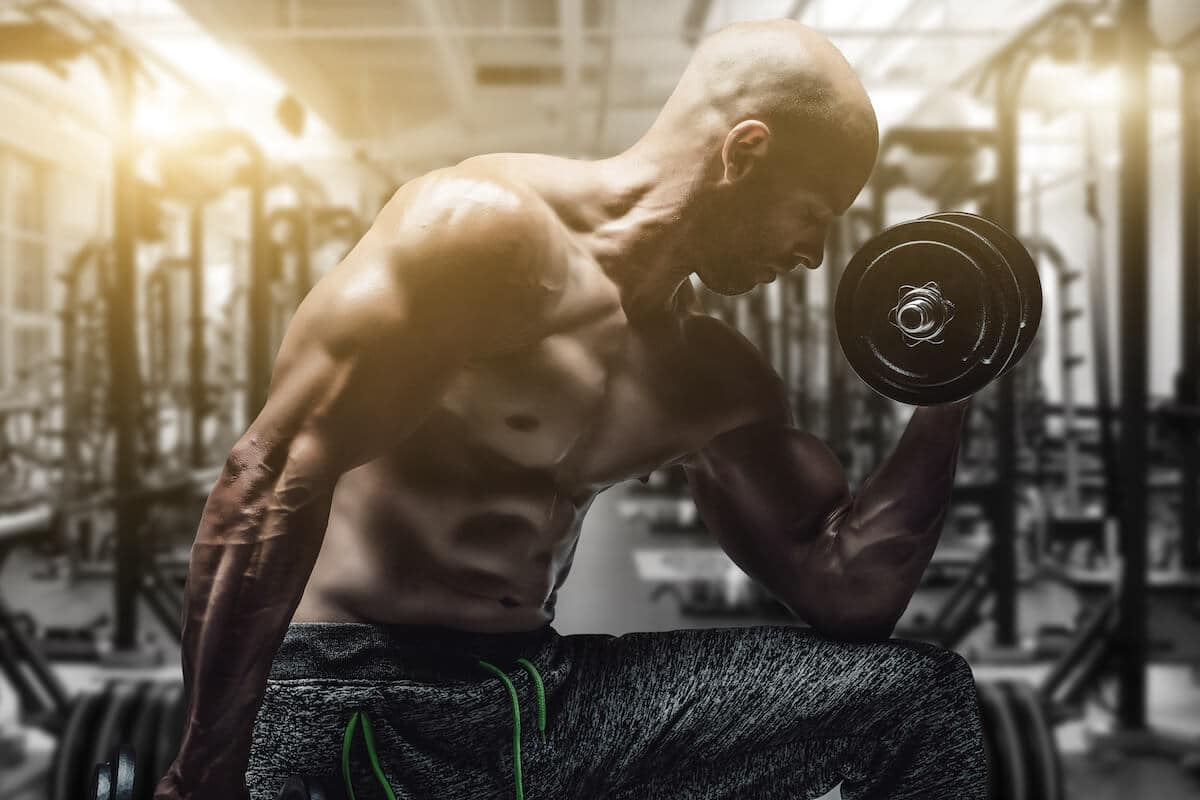 Bodybuilder exercising his arms with weights