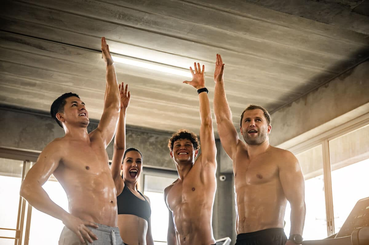 Muscle recovery supplements: fit people giving each other high fives