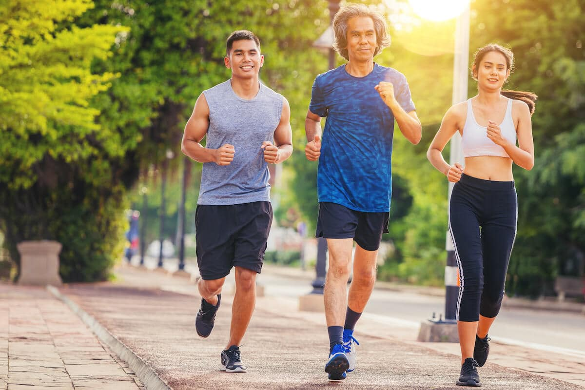 Three people jogging outdoors