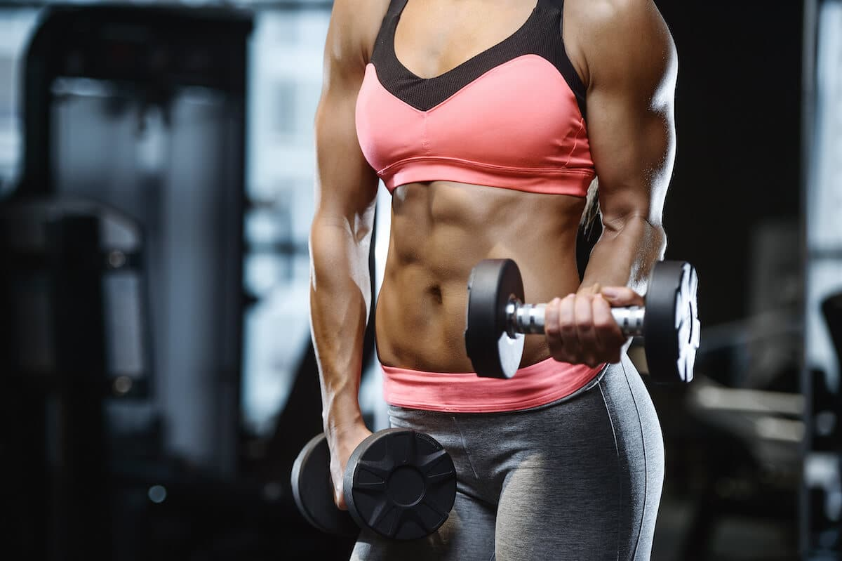 Lean muscle: woman lifting weights